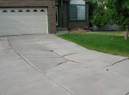 This driveway has sunk and cracked and is in need of mudjacking.